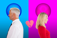 Composite image of couple not talking with broken heart between them Royalty Free Stock Images