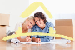Composite image of couple organizing their future home Royalty Free Stock Photography