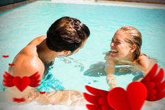 Composite image of couple in pool and valentines heart 3d. Hearts against happy couple laughing in pool Royalty Free Stock Photography