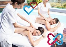 Composite image of couple receiving massage at spa Stock Photo