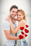 Composite image of couple and red hearts 3d Stock Photography