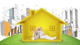 Composite image of couple relaxing while drinking coffee. Couple relaxing while drinking coffee against house shape with living room sketch Stock Photography