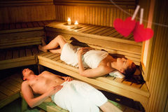 Composite image of couple relaxing in the sauna Stock Photos