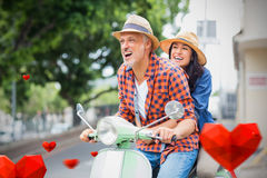 Composite image of couple on scooter and valentines hearts 3d Stock Photo