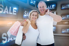 Composite image of couple with shopping bags Royalty Free Stock Image