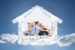 Composite image of couple sitting back-to-back Stock Photography
