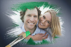 Composite image of couple smiling at camera Stock Photography