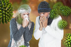 Composite image of couple sneezing in tissue Royalty Free Stock Photos