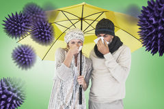 Composite image of couple sneezing in tissue while standing under umbrella royalty free stock photos