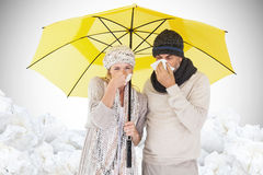 Composite image of couple sneezing in tissue while standing under umbrella Royalty Free Stock Images