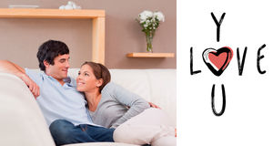 Composite image of couple on the sofa in love Stock Photos