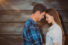 Composite image of couple standing head against head Stock Photo