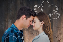Composite image of couple standing head against head Stock Photography