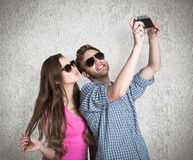 Composite image of couple taking selfie with digital camera Royalty Free Stock Photo