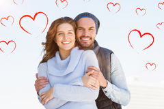 Composite image of couple and valentines hearts 3d Stock Photography