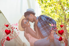 Composite image of couple and valentines hearts 3d. Valentines heart design against romantic young couple dancing 3d Stock Image