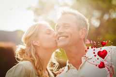 Composite image of couple and valentines hearts 3d Royalty Free Stock Photo