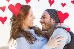 Composite image of couple and valentines hearts 3d Stock Images