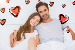 Composite image of couple and valentines hearts 3d Stock Photos