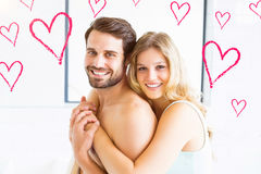 Composite image of couple and valentines hearts 3d Royalty Free Stock Photography