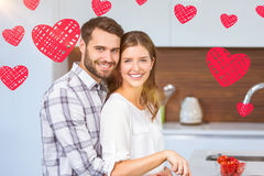 Composite image of couple and valentines hearts 3d Royalty Free Stock Photos
