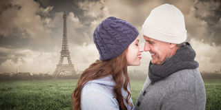 Composite image of couple in warm clothing facing each other Stock Photos