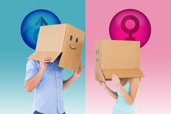 Composite image of couple wearing emoticon face boxes on their heads Stock Photo