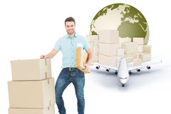 Composite image of courier man with cardboard boxes Royalty Free Stock Image