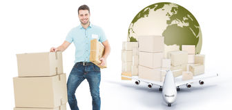 Composite image of courier man with cardboard boxes Stock Photos