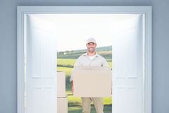 Composite image of courier man carrying cardboard box Royalty Free Stock Photos
