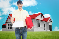 Composite image of courier man with red box giving clipboard Royalty Free Stock Photo