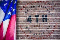 Composite image of creased us flag. Creased US flag against red brick wall stock illustration
