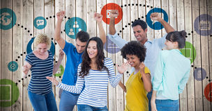 Composite image of creative business team having fun. Creative business team having fun against wooden planks background royalty free stock photo