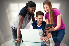 Composite image of creative team looking at digital tablet Royalty Free Stock Photography