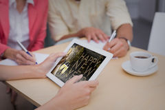 Composite image of creative team using tablet pc Royalty Free Stock Image