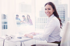 A Composite image of creative team working Stock Images