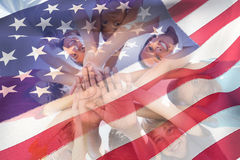 Composite image of cropped american flag. Cropped American flag against children hands stacked Royalty Free Stock Photography