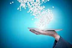 Composite image of cropped hand of businessman holding digital tablet 3d. Cropped hand of businessman holding digital tablet against blue vignette background 3d royalty free stock photography