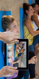 Composite image of cropped hand holding digital tablet Stock Photography