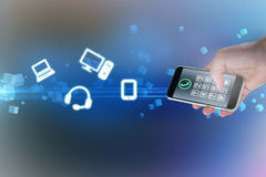 Composite image of cropped hand holding phone 3d Royalty Free Stock Images