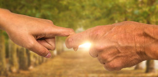 Composite image of cropped hands of people holding fingers Royalty Free Stock Photo