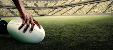 Composite image of cropped image of athlete holding rugby ball royalty free stock photos