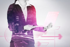 Composite image of cropped image of businesswoman holding laptop computer 3d. Cropped image of businesswoman holding laptop computer against illuminated roads by Royalty Free Stock Photo