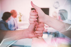 Composite image of cropped image of friends stacking fists Stock Photo