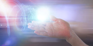 Composite image of cropped image of hand pretending to hold invisible object Royalty Free Stock Photography