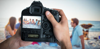 Composite image of cropped image of hands holding camera Royalty Free Stock Photography