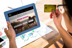 Composite image of cropped image of hipster businessman using tablet and credit card Royalty Free Stock Photo