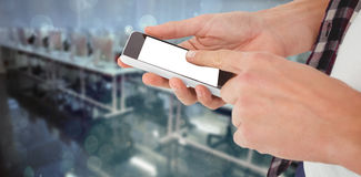 Composite image of cropped image of man using smartphone 3d Royalty Free Stock Images