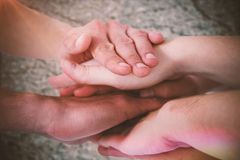 Composite image of cropped image of people forming hands stack Royalty Free Stock Photos