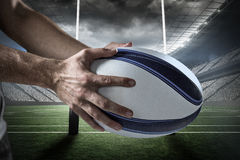 Composite image of cropped image of sports player holding ball 3D Royalty Free Stock Photography